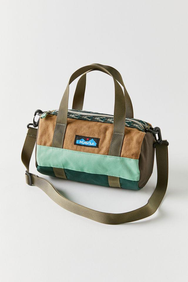 """<h2>KAVU Manastash Mini Duffle Bag</h2><br>Mini duffels travel well too. This 9.5"""" bag is great for hikes, quick packing, and sightseeing in style. <br><br><em>Shop <a href=""""https://www.urbanoutfitters.com/shop/kavu-manastash-mini-duffle-bag"""" rel=""""nofollow noopener"""" target=""""_blank"""" data-ylk=""""slk:KAVU"""" class=""""link rapid-noclick-resp""""><strong>KAVU</strong></a></em><br><br><strong>KAVU</strong> KAVU Manastash Mini Duffle Bag, $, available at <a href=""""https://go.skimresources.com/?id=30283X879131&url=https%3A%2F%2Fwww.urbanoutfitters.com%2Fshop%2Fkavu-manastash-mini-duffle-bag"""" rel=""""nofollow noopener"""" target=""""_blank"""" data-ylk=""""slk:Urban Outfitters"""" class=""""link rapid-noclick-resp"""">Urban Outfitters</a>"""