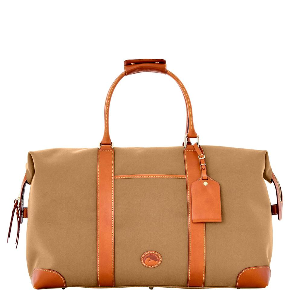 """<h2>Dooney & Bourke Getaway Cabriolet Medium Duffle </h2><br>On the outside, this bag flaunts a simple and classic design with waterproof Cabriolet cloth, cowhide leather trim, and handstitched handles. Open it up and you'll find its vibrant cotton-lined interior and three handy-dandy pockets. One reviewer notes, """"Love all the pockets for passports, phones, and other travel documents.""""<br><br><em>Shop </em><strong><em><a href=""""https://www.dooney.com/getaway-cabriolet-medium-duffle-C1802BL.html"""" rel=""""nofollow noopener"""" target=""""_blank"""" data-ylk=""""slk:Dooney & Bourke"""" class=""""link rapid-noclick-resp"""">Dooney & Bourke</a></em></strong><br><br><strong>Dooney & Bourke</strong> Getaway Cabriolet Medium Duffle, $, available at <a href=""""https://go.skimresources.com/?id=30283X879131&url=https%3A%2F%2Fdooney.com%2Fgetaway-cabriolet-medium-duffle-C1802.html"""" rel=""""nofollow noopener"""" target=""""_blank"""" data-ylk=""""slk:Dooney & Bourke"""" class=""""link rapid-noclick-resp"""">Dooney & Bourke</a>"""