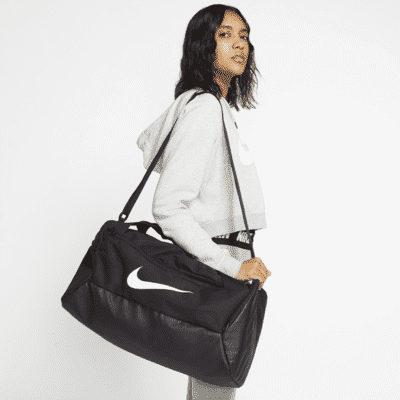 """<h2>Nike Brasilia </h2><br>For a more affordable option, shop Nike's large and in charge Brasilia bag. According to one reviewer, it's, """"fairly large and fits all [their] needs.""""<br><br><em>Shop <strong><a href=""""https://www.nike.com/t/brasilia-training-duffel-bag-small-pJzb5G/BA5957-010"""" rel=""""nofollow noopener"""" target=""""_blank"""" data-ylk=""""slk:Nike"""" class=""""link rapid-noclick-resp"""">Nike</a></strong></em><br><br><strong>Nike</strong> Nike Brasilia, $, available at <a href=""""https://go.skimresources.com/?id=30283X879131&url=https%3A%2F%2Fwww.nike.com%2Ft%2Fbrasilia-training-duffel-bag-small-pJzb5G%2FBA5957-010"""" rel=""""nofollow noopener"""" target=""""_blank"""" data-ylk=""""slk:Nike"""" class=""""link rapid-noclick-resp"""">Nike</a>"""