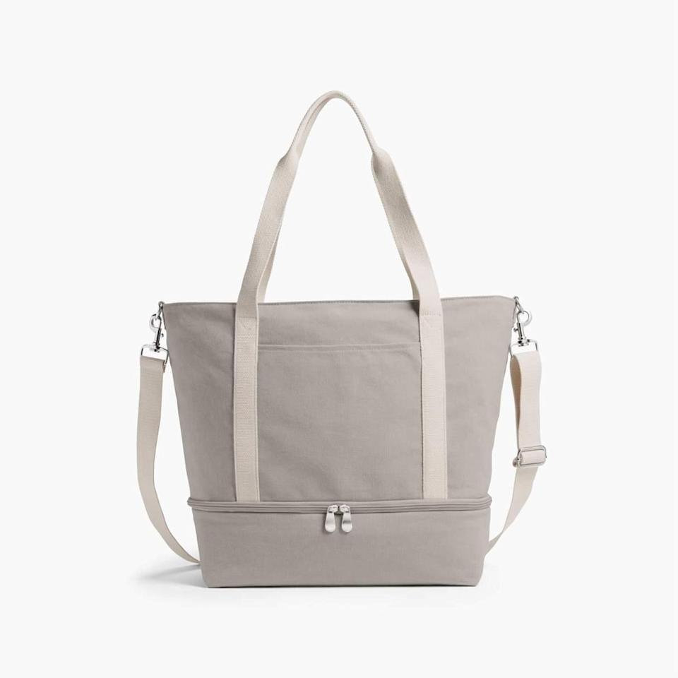 """<h2>Lo & Sons Catalina Deluxe Tote</h2><br>R29 readers are no stranger to Lo & Sons' quality boutique bags. The brand's Catalina collection is ideal for getaways. Durable enough for whatever adventures you take it on, features like a bottom pocket and adjustable compartments and straps make it a savvy traveler's best friend. <br><br><em>Shop <a href=""""https://www.loandsons.com/pages/discover-catalina-collection"""" rel=""""nofollow noopener"""" target=""""_blank"""" data-ylk=""""slk:Lo & Sons"""" class=""""link rapid-noclick-resp""""><strong>Lo & Sons</strong></a></em><br><br><strong>Lo & Sons</strong> The Catalina Deluxe Tote, $, available at <a href=""""https://go.skimresources.com/?id=30283X879131&url=https%3A%2F%2Fwww.loandsons.com%2Fproducts%2Fcatalina-deluxe-tote-washed-canvas-dove-grey"""" rel=""""nofollow noopener"""" target=""""_blank"""" data-ylk=""""slk:Lo & Sons"""" class=""""link rapid-noclick-resp"""">Lo & Sons</a>"""