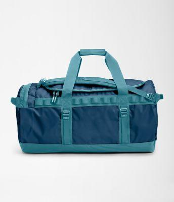 """<h2>The North Face Base Camp Duffel <br></h2><br>In The North Face travel bags we trust. The medium Base Camp Duffel can be toted in hand or carried on one's back, is water-resistant, and according to one reviewer it's, """"...a bomb-proof bag.""""<br><br><em>Shop <a href=""""https://www.thenorthface.com/shop/equipment-luggage-duffels-duffels/base-camp-duffel-medium-nf0a52sa"""" rel=""""nofollow noopener"""" target=""""_blank"""" data-ylk=""""slk:The North Face"""" class=""""link rapid-noclick-resp""""><strong>The North Face</strong></a></em><br><br><strong>The North Face</strong> Base Camp Duffel - M, $, available at <a href=""""https://go.skimresources.com/?id=30283X879131&url=https%3A%2F%2Fwww.thenorthface.com%2Fshop%2Fequipment-luggage-duffels-duffels%2Fbase-camp-duffel-medium-nf0a52sa"""" rel=""""nofollow noopener"""" target=""""_blank"""" data-ylk=""""slk:The North Face"""" class=""""link rapid-noclick-resp"""">The North Face</a>"""