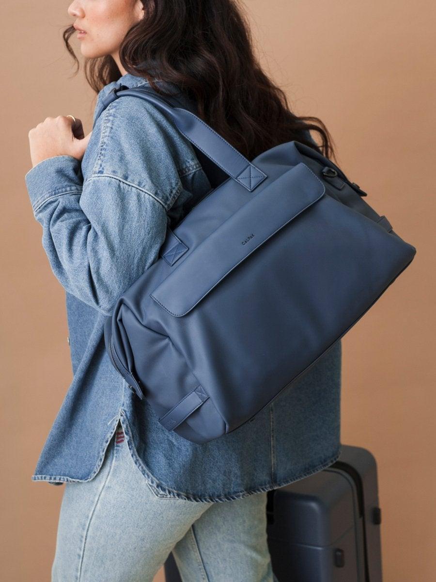 "<h2>Calpak Hue Duffel Bag</h2><br>Described as a minimalist duffel with maximum style, Calpak's Hue bag features a luggage sleeve, laptop compartment, discreet cell phone pocket, and exterior side handles.<br><br><em>Shop <strong><a href=""https://www.calpaktravel.com/products/hue-duffel/atlantic"" rel=""nofollow noopener"" target=""_blank"" data-ylk=""slk:Calpak"" class=""link rapid-noclick-resp"">Calpak</a></strong></em><br><br><strong>Calpak</strong> Hue Duffel Bag, $, available at <a href=""https://go.skimresources.com/?id=30283X879131&url=https%3A%2F%2Fwww.calpaktravel.com%2Fproducts%2Fhue-duffel%2Fatlantic"" rel=""nofollow noopener"" target=""_blank"" data-ylk=""slk:Calpak"" class=""link rapid-noclick-resp"">Calpak</a>"