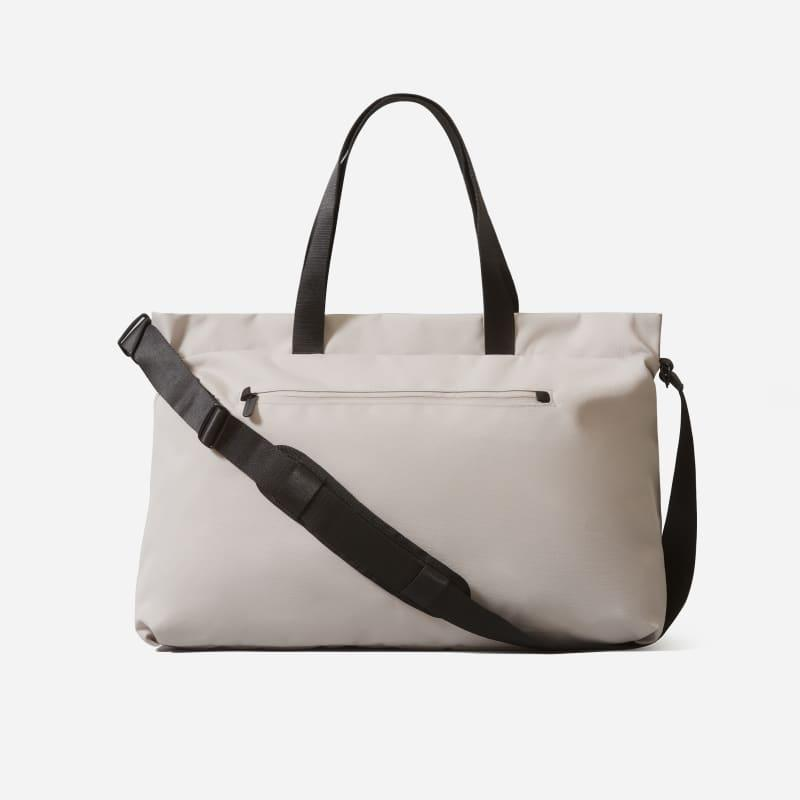 """<h2>Everlane The ReNew Transit Weekender</h2><br>Since the brand's beloved <a href=""""https://www.everlane.com/products/womens-twill-weekender-reverse-denim-black-leather"""" rel=""""nofollow noopener"""" target=""""_blank"""" data-ylk=""""slk:Twill Weekender bag"""" class=""""link rapid-noclick-resp"""">Twill Weekender bag</a> is sold out, we found the next best thing: the ReNew Transit Weekender. This duffel is great for vacays, but can also be put to use as an everyday commuter bag (if you like to pack heavy).<br><br><em>Shop <strong><a href=""""https://www.everlane.com/products/womens-renew-weekender-quartz"""" rel=""""nofollow noopener"""" target=""""_blank"""" data-ylk=""""slk:Everlane"""" class=""""link rapid-noclick-resp"""">Everlane</a></strong></em><br><br><strong>Everlane</strong> The ReNew Transit Weekender, $, available at <a href=""""https://go.skimresources.com/?id=30283X879131&url=https%3A%2F%2Feverlane.com%2Fproducts%2Fwomens-renew-weekender-quartz"""" rel=""""nofollow noopener"""" target=""""_blank"""" data-ylk=""""slk:Everlane"""" class=""""link rapid-noclick-resp"""">Everlane</a>"""