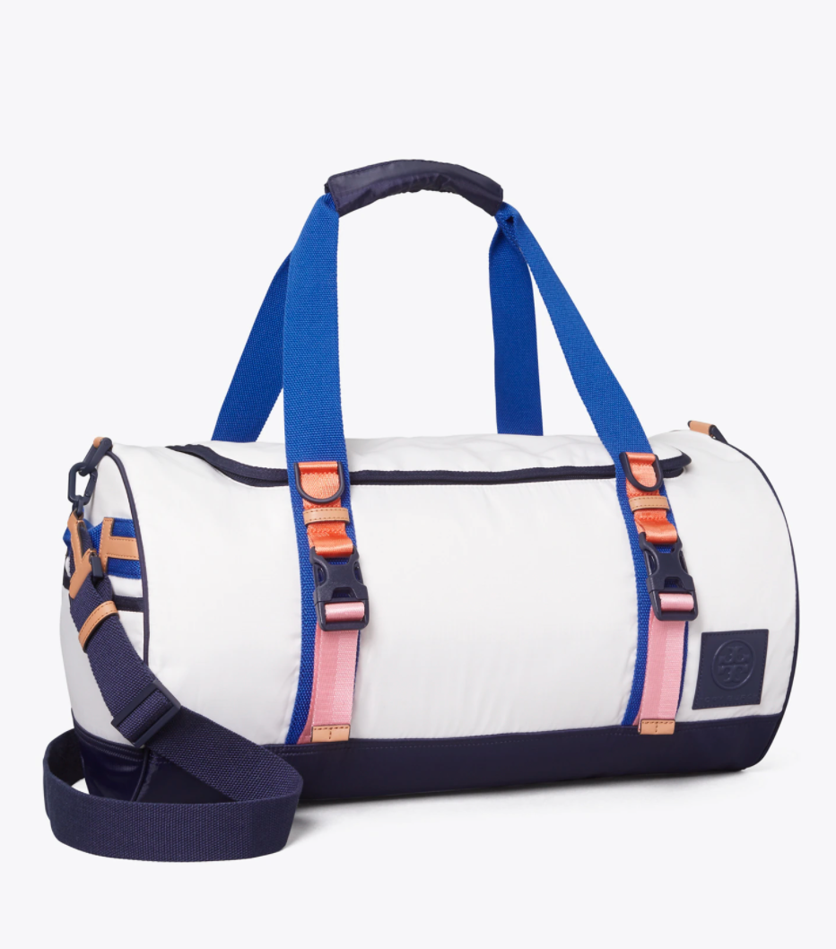 """<h2>Tory Sport Ripstop Nylon Color-Block Duffle Bag</h2><br>Color-blocking, retro design, and lightweight materials make this designer duffel the perfect sporty travel companion. Some must-have features include (but are not limited to): a removable crossbody strap, shoe compartment, and its 2-in-1 convertible style. <br><br><em>Shop <strong><a href=""""https://www.toryburch.com/en-us/ripstop-nylon-color-block-duffle-bag/73900.html"""" rel=""""nofollow noopener"""" target=""""_blank"""" data-ylk=""""slk:Tory Burch"""" class=""""link rapid-noclick-resp"""">Tory Burch</a></strong></em><br><br><strong>Tory Sport</strong> Ripstop Nylon Color-Block Duffle Bag, $, available at <a href=""""https://go.skimresources.com/?id=30283X879131&url=https%3A%2F%2Fwww.toryburch.com%2Fen-us%2Fripstop-nylon-color-block-duffle-bag%2F73900.html"""" rel=""""nofollow noopener"""" target=""""_blank"""" data-ylk=""""slk:Tory Burch"""" class=""""link rapid-noclick-resp"""">Tory Burch</a>"""
