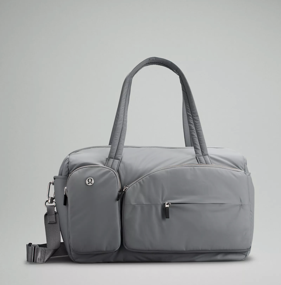 """<h2>Lululemon Curved Lines Large Duffle Bag 29.5L</h2><br>Pockets, pockets, and more pockets. Lululemon's large duffel bag is here to keep every one of your essentials accessible and organized and make your travels easy as pie. <br><br><em>Shop <a href=""""https://shop.lululemon.com/p/bags/Curved-Lines-Duffle/_/prod10520259"""" rel=""""nofollow noopener"""" target=""""_blank"""" data-ylk=""""slk:Lululemon"""" class=""""link rapid-noclick-resp""""><strong>Lululemon</strong></a></em><br><br><strong>Lululemon</strong> Curved Lines Large Duffle Bag, $, available at <a href=""""https://go.skimresources.com/?id=30283X879131&url=https%3A%2F%2Fshop.lululemon.com%2Fp%2Fbags%2FCurved-Lines-Duffle%2F_%2Fprod10520259"""" rel=""""nofollow noopener"""" target=""""_blank"""" data-ylk=""""slk:Lululemon"""" class=""""link rapid-noclick-resp"""">Lululemon</a>"""